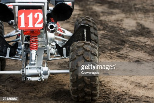 Close-up of a quadbike on sand : Foto de stock
