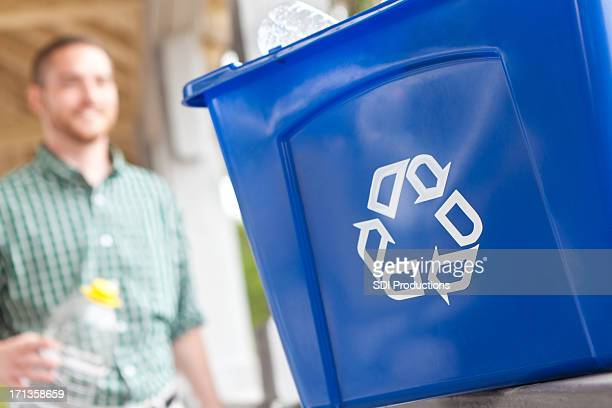 Closeup of a recycle bin being used with recycled items