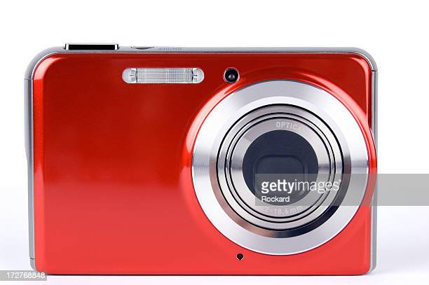 Close-up of a red digital camera on a white background