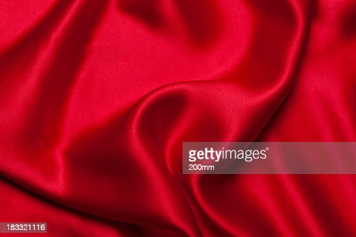 A close-up of a red silk cloth