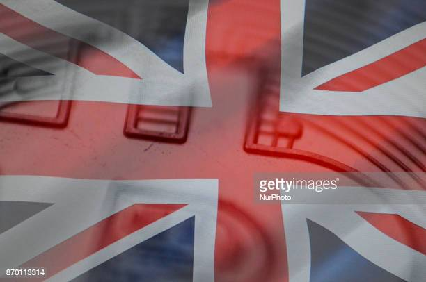A closeup of a replica bitcion is seen with a British flag in this photo illustration on November 4 2017