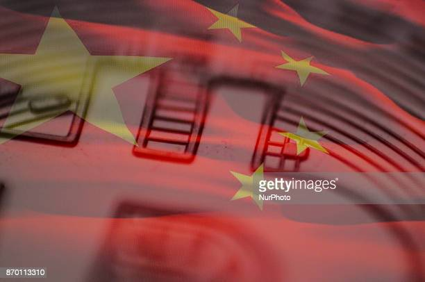 A closeup of a replica bitcion is seen with a Chinese flag in this photo illustration on November 4 2017