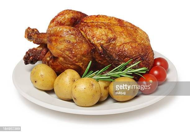 Close-up of a roasted barbecue chicken with potatoes
