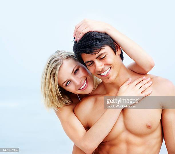 Close-up of a romantic young couple smiling on the beach