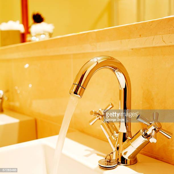 Close-up of a running tap in a bathroom
