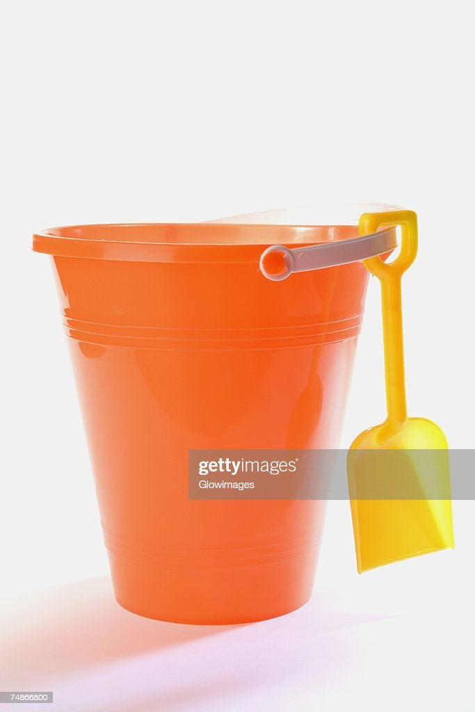 Close-up of a sand pail and a shovel