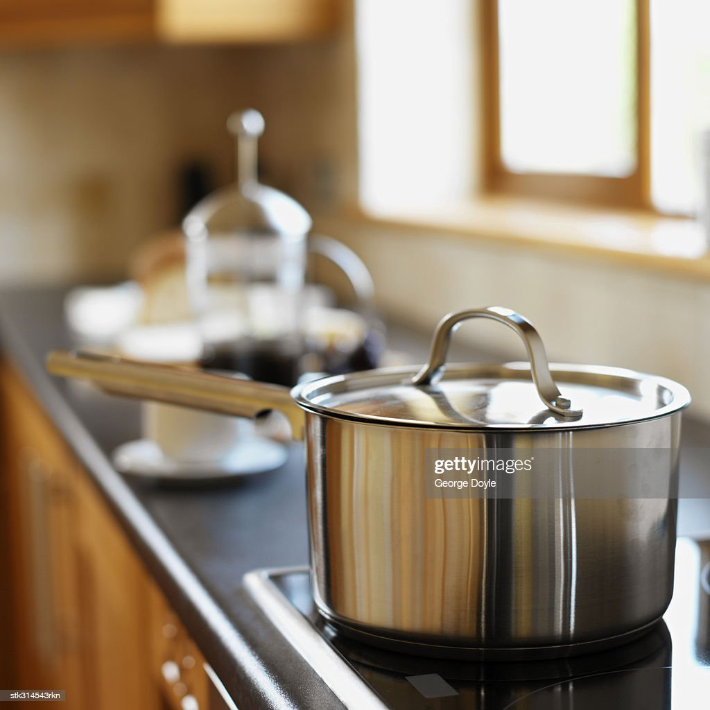 close-up of a saucepan on a burner in the kitchen