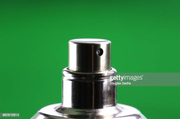 Close-up of a scented perfume spray bottle
