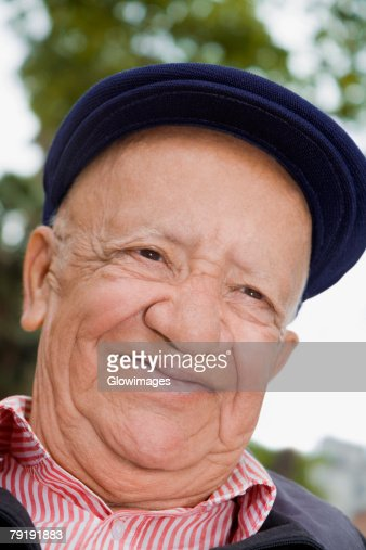 Close-up of a senior man smiling : Stock Photo