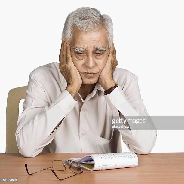 Close-up of a senior man thinking