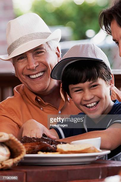 Close-up of a senior man with his grandson smiling in a restaurant