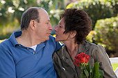 Close-up of a senior romantic couple in a park