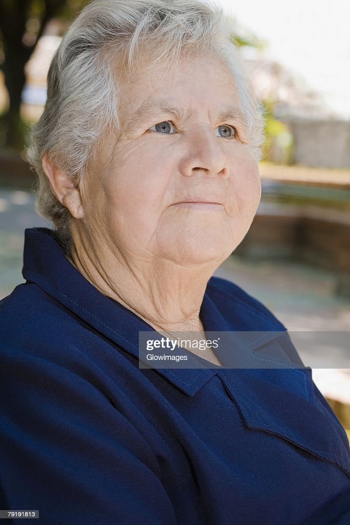 Close-up of a senior woman looking up : Stock Photo