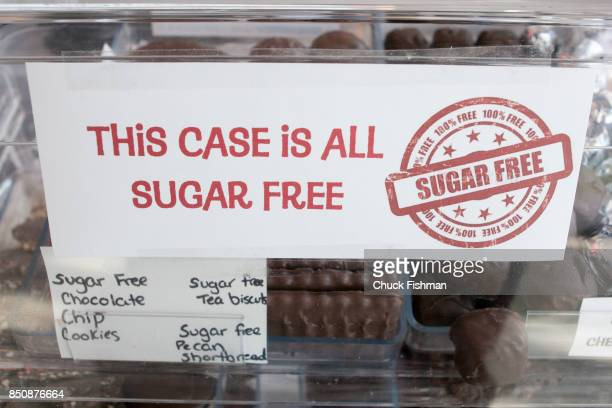 Closeup of a sign that reads in part 'This Case Is All Sugar Free' on a glass display case during the Chocolate Expo at the Cradle of Aviation museum...