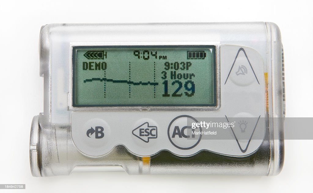 Close-up of a silver insulin pump with readings on screen