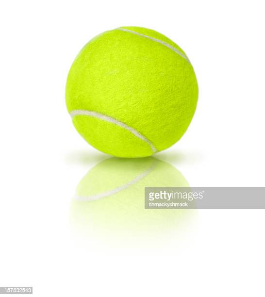Close-up of a single green tennis ball over a white surface