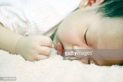 Close-up of a sleeping boy : Stock Photo