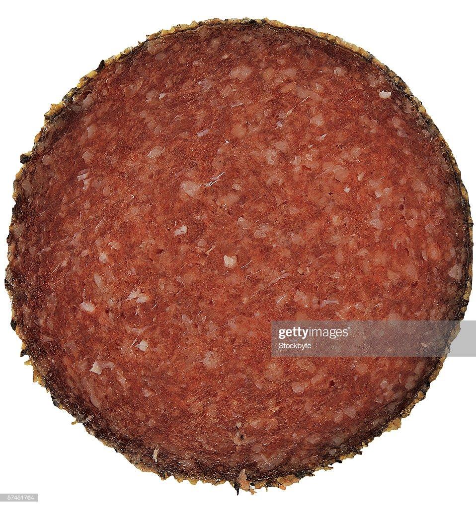 close-up of a slice of salami