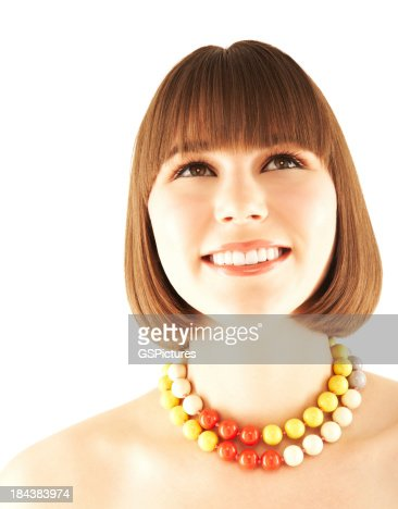 Close-up of a smiling teenage girl wearing colorful beaded neckl