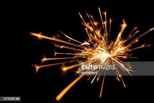 Close-up of a sparkler on black background