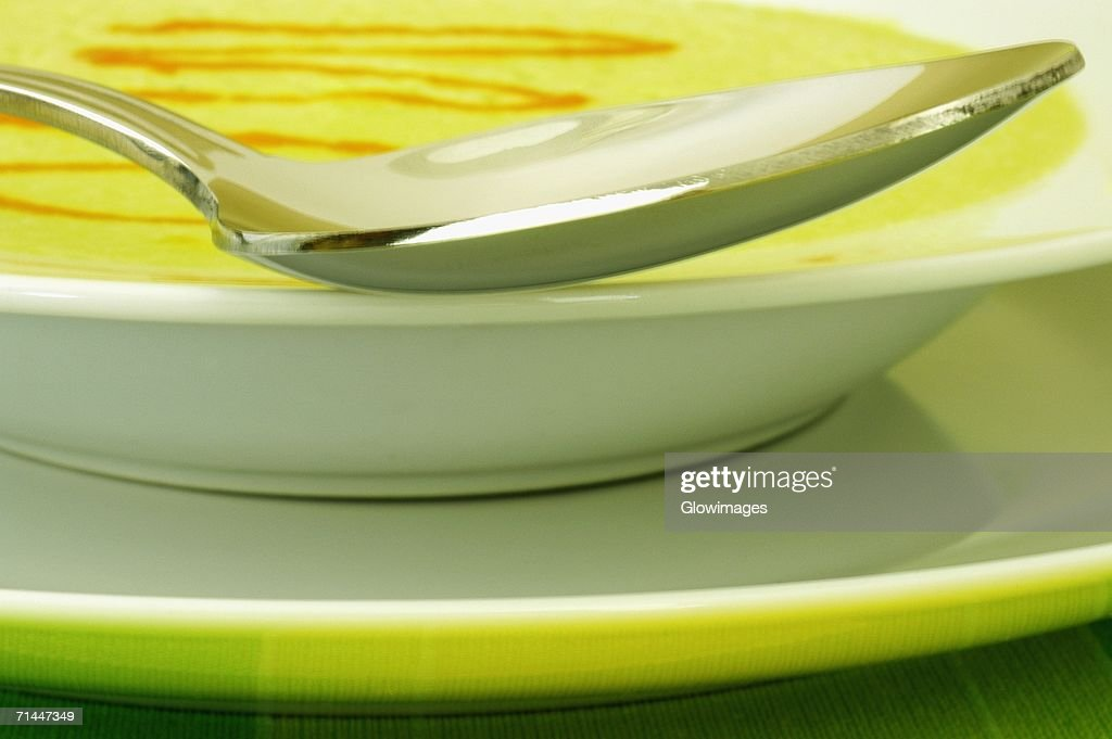 Close-up of a spoon in a bowl : Stock Photo