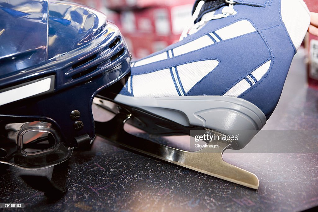 Close-up of a sports helmet with an ice-skate : Stock Photo