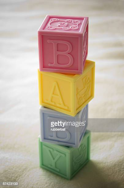 Close-up of a stack of alphabet blocks