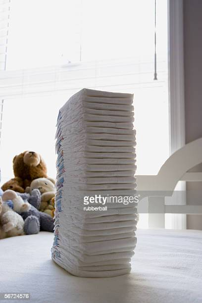 Close-up of a stack of diapers on a table