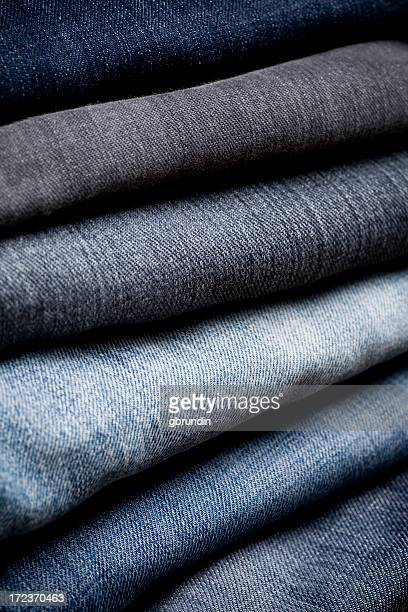 Close-up of a stack of different colored folded denim