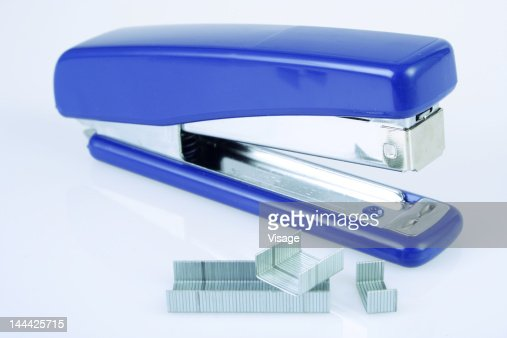 Close-up of a Stapler beside pins
