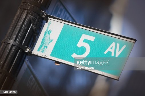 Close-up of a street name sign on an information board, Manhattan, New York City, New York State, USA