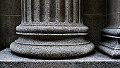 Close-up of a strong supportive pillar base.