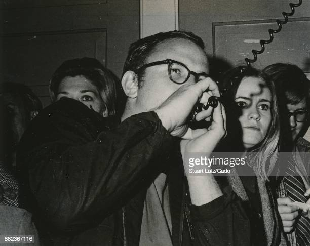 Closeup of a student speaking into the microphone of a bullhorn loudspeaker during an anti Vietnam War student sitin protest at North Carolina State...