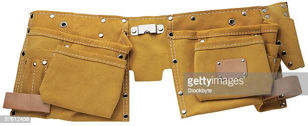 close-up of a suede tool belt