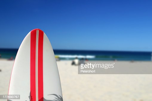 Close-up of a surfboard on an out of focus Malibu beach