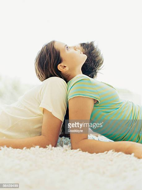 close-up of a teenage couple lying back to back
