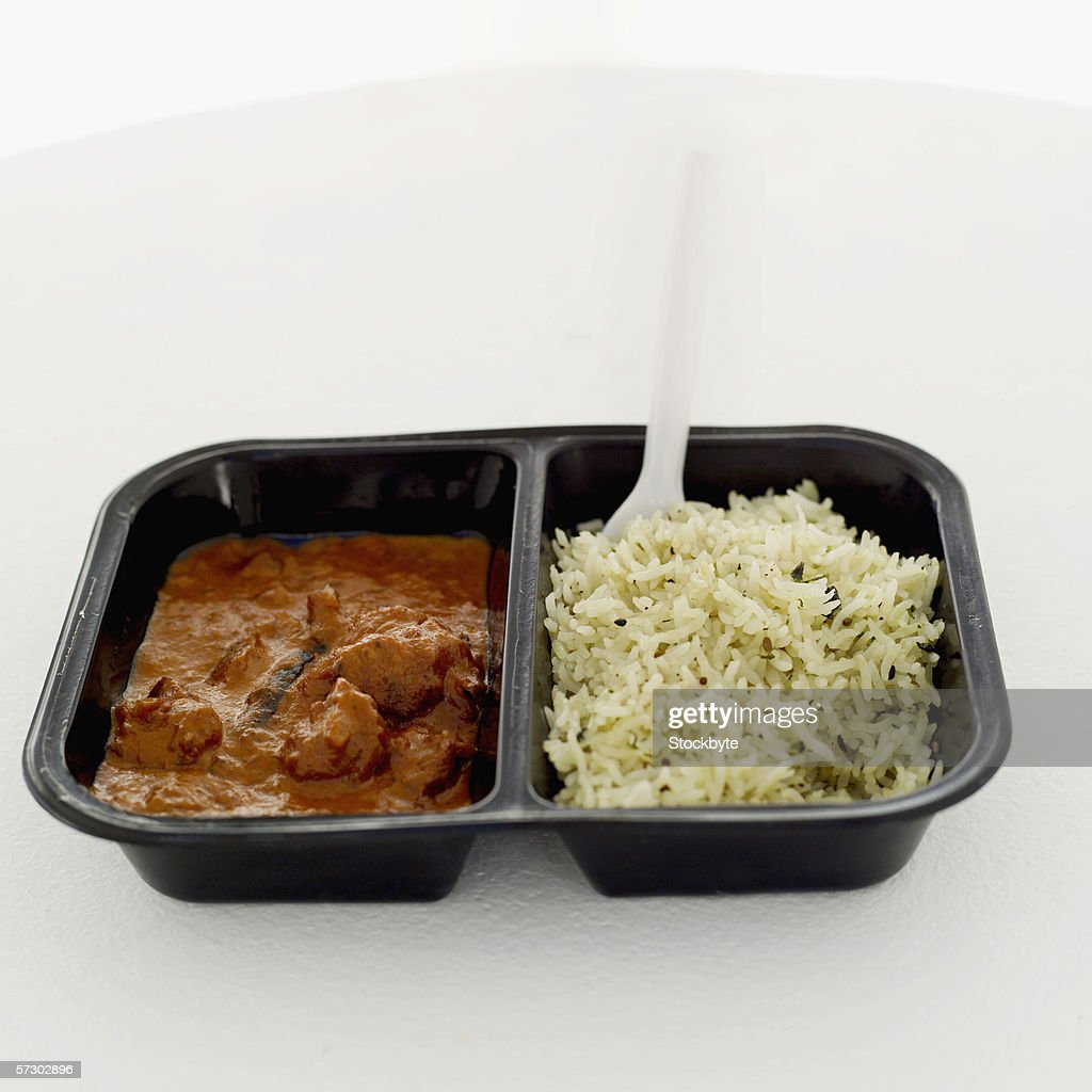 Close-up of a tray of curry and rice : Stock Photo