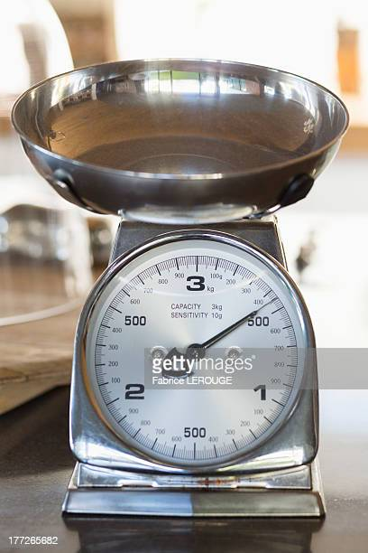 Close-up of a weighing scale at a kitchen counter