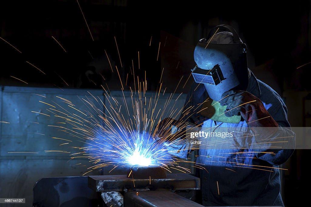 Close-up of a welder wielding sparks