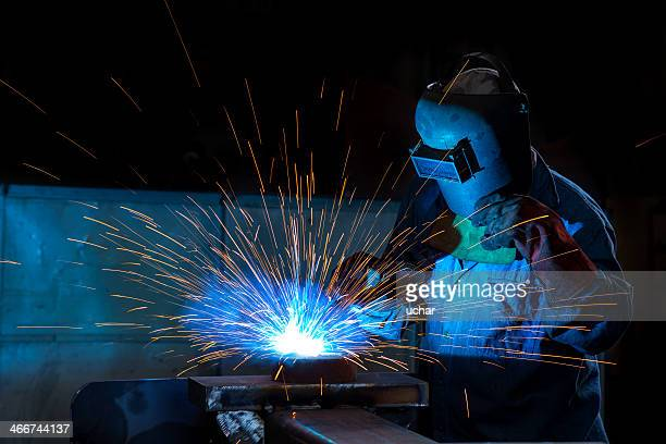 Close-up of a welder wielding sparks