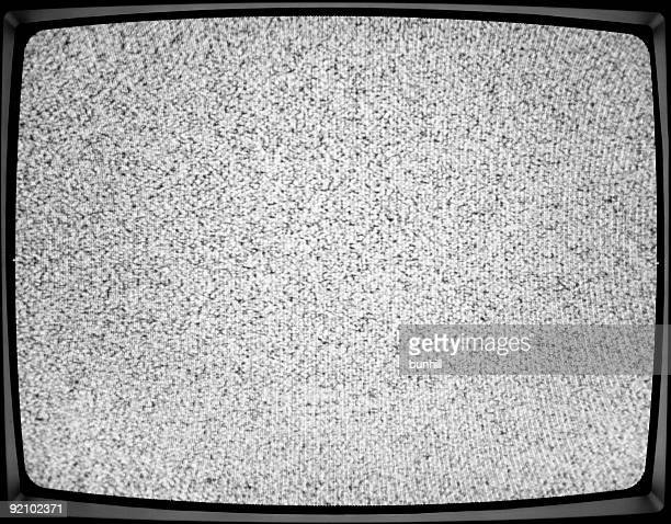 A close-up of a white noise on a TV screen