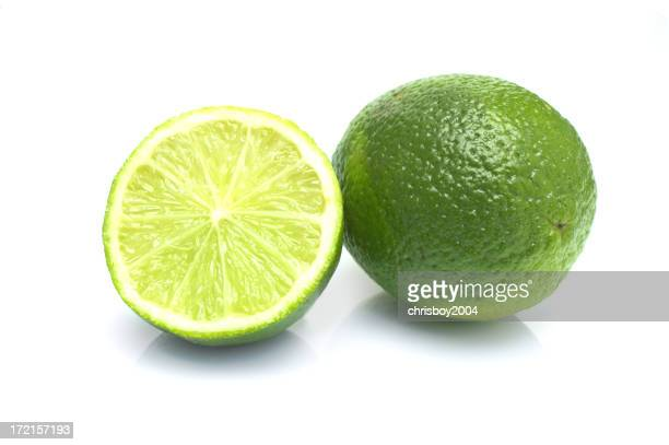 Close-up of a whole lime and one cut lime
