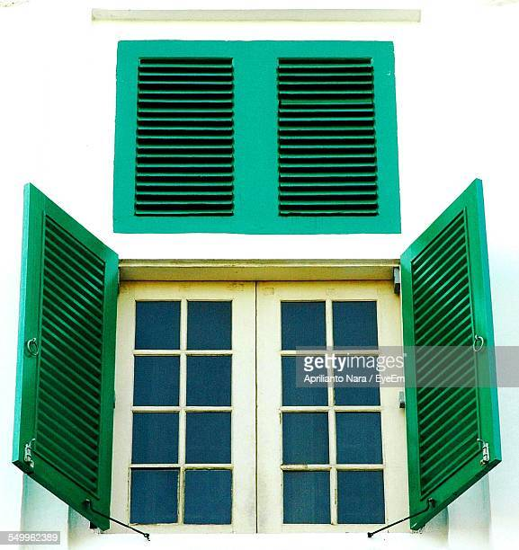 Close-Up Of A Window With Green Shutters
