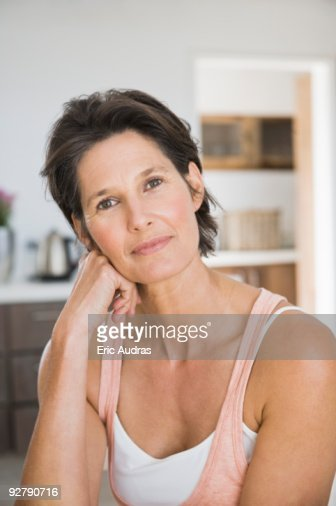 Close-up of a woman day dreaming : Stock Photo