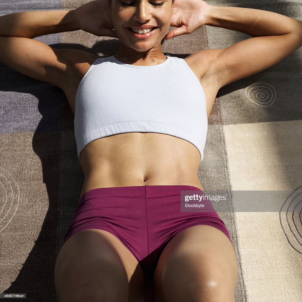 close-up of a woman doing abdominal crunches : Stock Photo
