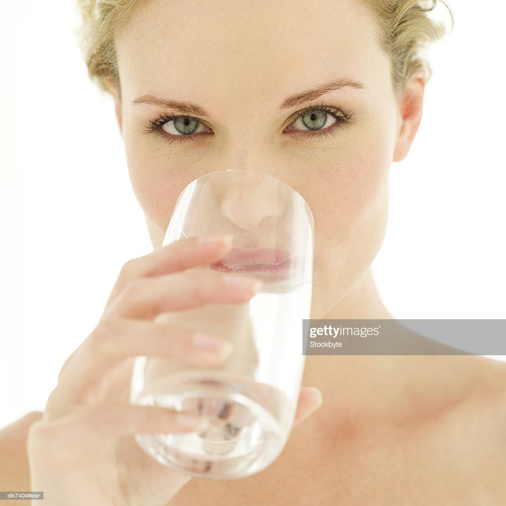 Close-up of a woman drinking water from a glass : Stock Photo