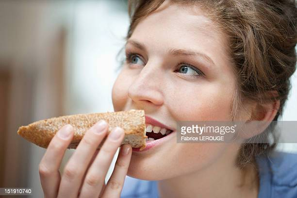 Close-up of a woman eating toast