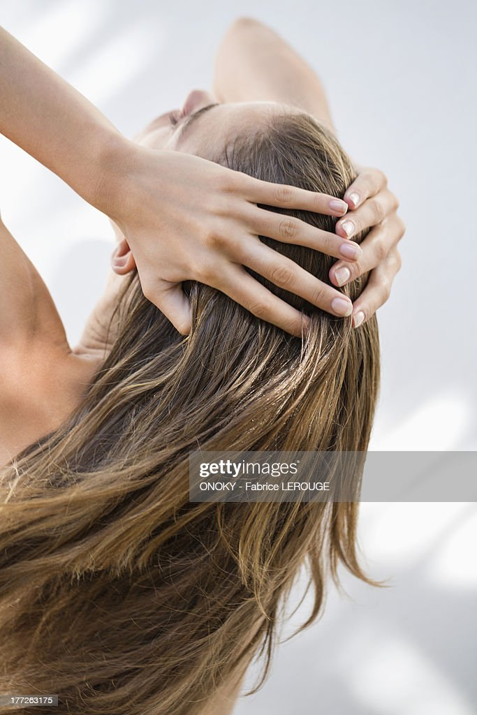 Close-up of a woman holding her hair