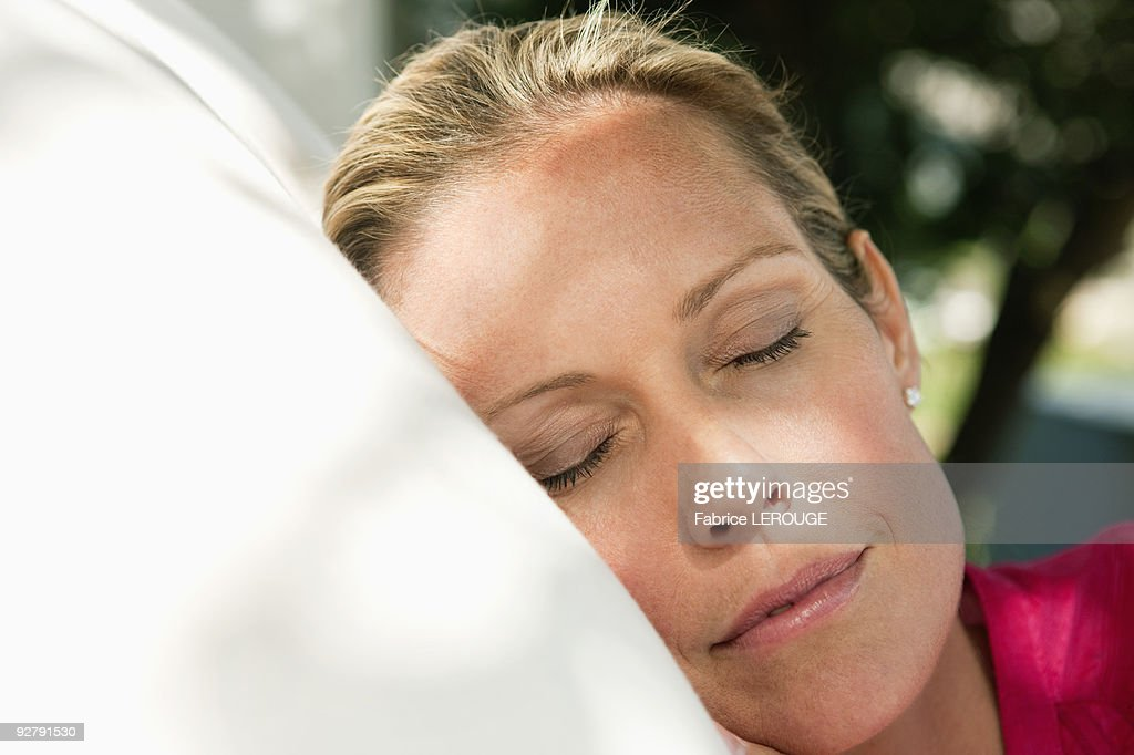 Close-up of a woman napping : Stock Photo