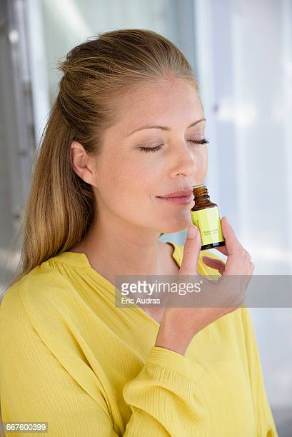 Close-up of a woman smelling tea tree oil